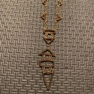 Gold tribal patterned long dainty nacklace